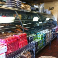 Photo taken at Scott's Generations Deli by Elise K. on 5/7/2012