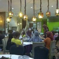 Photo taken at Restoran Kayu Manis by Ahmad S. on 8/5/2012