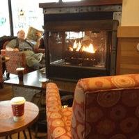 Photo taken at Starbucks by Liz on 1/1/2012
