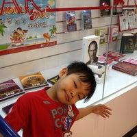 Photo taken at Popular Bookstore by Sharifah N. on 3/25/2012