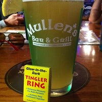 Photo taken at Mullen's Bar and Grill by Sarah C. on 8/13/2011