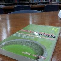 Photo taken at Satang Library by Thanapong K. on 10/6/2011