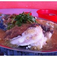 Photo taken at Batu 11 Fish Head by Joyce L. on 1/16/2011