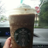 Photo taken at Starbucks by Nilza A. on 4/1/2012