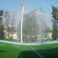 Photo taken at Estadio Panamericano de Hockey by Marco R. on 10/20/2011