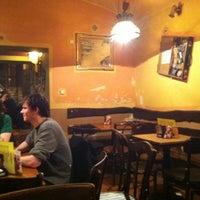 Photo taken at PopoCafePetl Café/Bar by Pavel N. on 4/5/2012