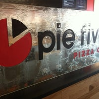 Photo taken at Pie Five Pizza Co. by Eric O. on 7/8/2012