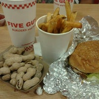 Photo taken at Five Guys by Steph B. on 7/4/2012