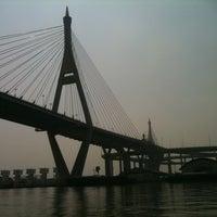 Photo taken at Bhumibol 1 Bridge by Thanwa N. on 1/20/2011