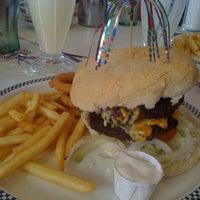 Photo taken at Woodies Longboard Diner by Charlie N. on 10/26/2011