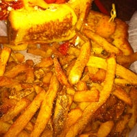 Photo taken at Gooeyz Grilled Cheese by J H. on 4/2/2011