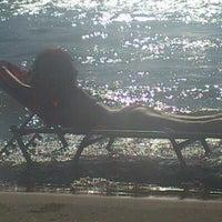 Photo taken at Kini Beach by Magda P. on 8/17/2012