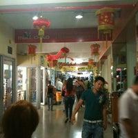 Photo taken at Mall Chino by Carolina C. on 1/13/2011