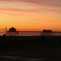 Photo taken at Huntington State Beach by B on 12/5/2011
