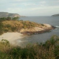 Photo taken at Praia do Sossego by Rodrigo O. on 9/1/2012