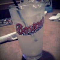 Photo taken at Boston's Restaurant & Sports Bar by Jeannie C. on 7/1/2012