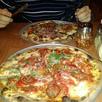 Photo taken at Nino's Coal Fired Pizza by Sam P. on 12/24/2011