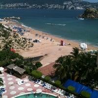 Photo taken at Hotel Playa Suites by Gus B. on 8/18/2012