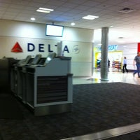 Photo taken at Gate A10 by William J. on 12/31/2011