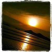Photo taken at Praia da Baleia by Caca B. on 2/25/2012