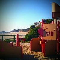Photo taken at Aliso Beach by Joy M. on 10/12/2011