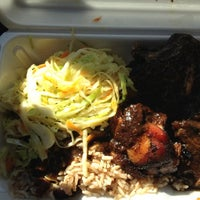 Photo taken at Jerkfish Jamaican Restaurant by Aya P. on 10/25/2011
