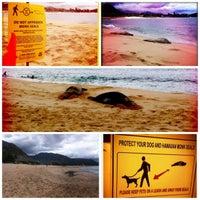 Photo taken at Makaha Beach Park by Ashley O. on 7/22/2012