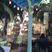 Photo taken at Kokomo's Island Cafe by Audrey O. on 4/27/2012