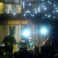 Photo taken at Jazzbah by Natalia L. on 1/22/2012