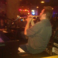Photo taken at Lucille's Piano Bar & Grill by Benjamin J. on 12/3/2011