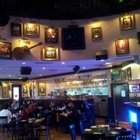 Photo taken at Hard Rock Cafe by Yuri B. on 6/12/2012