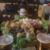 Photo taken at Kiosque Beer Grill by Barbara A. on 8/15/2012