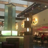 Photo taken at Atrium Lounge - Marriott Marquis by Sarah S. on 2/18/2012