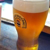 Photo taken at Tigín Irish Pub and Restaurant by Graham G. on 7/29/2012