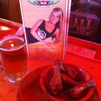 Photo taken at Ker's WingHouse Bar & Grill by Justin S. on 4/2/2011