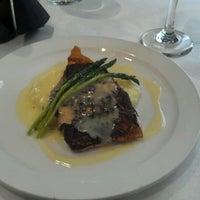 Photo taken at Zebra Restaurant & Wine Bar by Myra A. on 2/20/2012