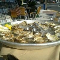 Photo taken at Fish Urban Dining by Corinne C. on 8/18/2012