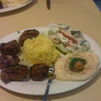 Photo taken at Aladdin's Mediterranean Grill & Deli by Johnny R. on 12/3/2011