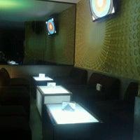 Photo taken at Irlandés lounge by Mariana G. on 8/3/2012