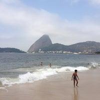 Photo taken at Praia do Flamengo by Guilherme A. on 9/7/2012