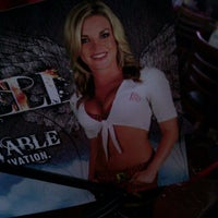 Photo taken at Tilted Kilt Pub & Eatery by Aaron B. on 1/11/2011