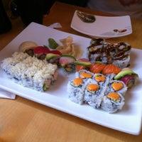 Photo taken at Momo Sushi & Cafe by Ben W. on 4/21/2012