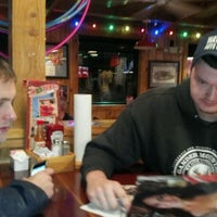 Photo taken at Hooters by David H. on 12/16/2011