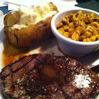 Photo taken at Smokey Bones Bar & Fire Grill by Chris B. on 9/3/2011