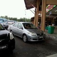 Photo taken at Kuching Bus Terminal by Mohamad H. on 10/13/2011