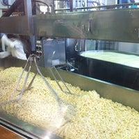 Photo taken at Beecher's Handmade Cheese by Cat P. on 12/7/2011
