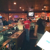 Photo taken at Tomatoes Restaurant & Sports Bar by Chrissy B. on 9/23/2011
