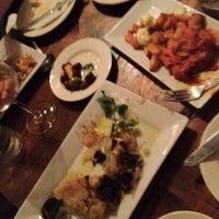Photo taken at Tasca Spanish Tapas Restaurant & Bar by Amir G. on 7/11/2012