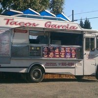 Photo taken at Tacos Garcia by Steven G. on 9/20/2011