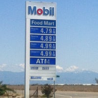 Photo taken at Mobil by Dave K. on 3/26/2012